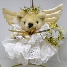 Christmas ornament Teddy Bear angel holding a wreath