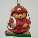 Christmas ornament Avon Holiday Package Topper Fireman 1997