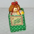 Vintage Enesco miniature Christmas Ornament 1986 Merry Christmas gift bag with doll and ball