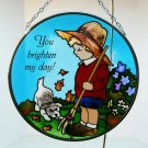 Joan Baker Designs art glass suncatcher Little Boy and Dog 4-1/2 inches diameter 2004