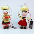2 Hershey's Chocolate ornaments Christmas elf chef man sewing a hat and woman holding a present