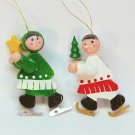 2 vtg Christmas ice skating ornaments wooden skaters Taiwan