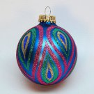 glass multi color Christmas ornament with glitter paisley design