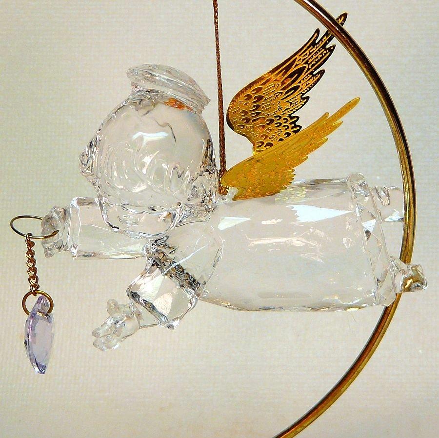 Clear acrylic angel Christmas ornament holding heart