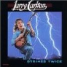 larry carlton - strikes twice CD 1988 MCA warner 8 tracks used mint