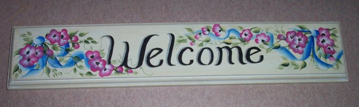 welcome wilth painted blue ribbon & small pink flowers