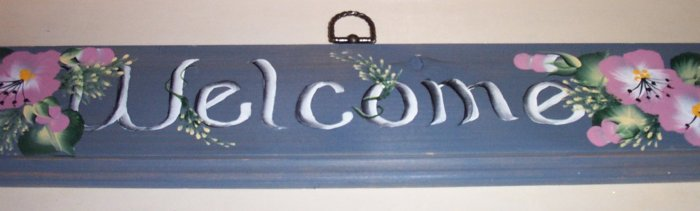Welcome sign with blue gray background