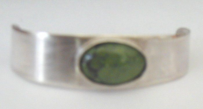 silver bracelet w/ green turquoise oval stone