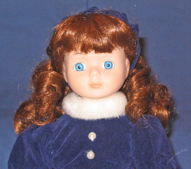 Victorian Girl porcelain doll 13in tall in blue winter dress