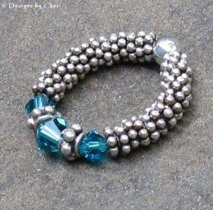Bali Daisy Ring... Blue Zircon Swarovski Crystals, Flex Fit Stretch