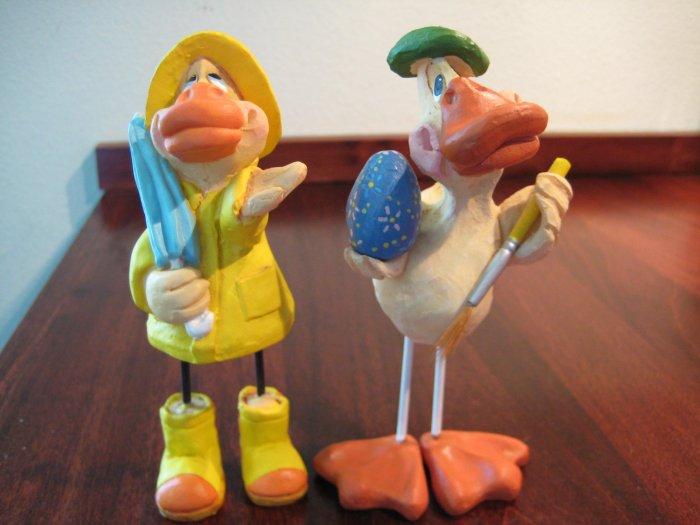 2 Russ Berrie Ducks by Kathleen Kelly - 1 in Rain Gear , 1 Painting an Egg.