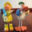 2 Russ Berrie Ducks by Kathleen Kelly - 1 in Rain Gear , 1 Painting an Egg.