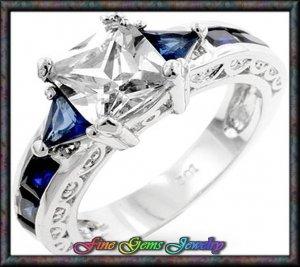 White Princess Cut w Blue Trillion & Emerald Cut Cz Silver Plt  Ring - Sz 5