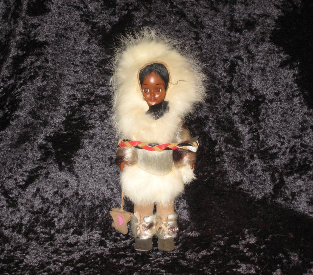 old doll with fur costume
