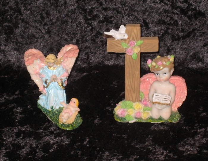 2 Porcelain angel figurines, boy and girl, religious theme