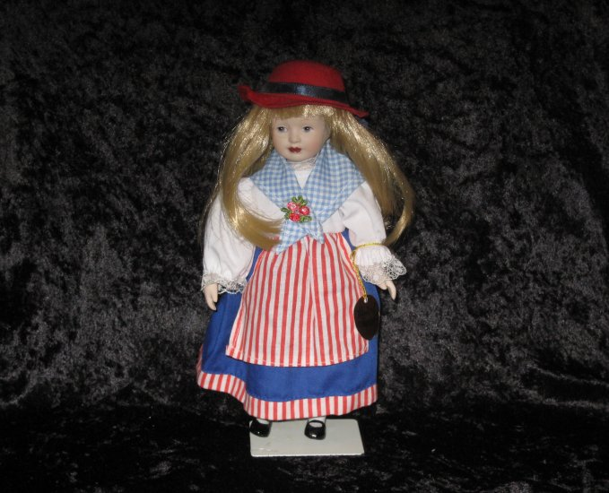 Porcelain dolls of the world, handpainted USA doll, 9 inches, with stand