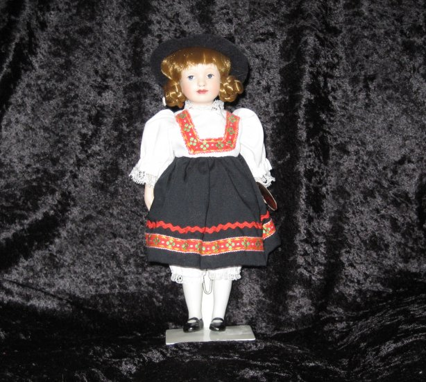 Porcelain dolls of the world, handpainted GERMANY doll, 9 inches, with stand