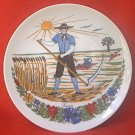 1981 SUMMER GERMAN COLLECTIBLE PLATE ~FARMER WITH SCYTHE~COLORFUL