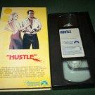 HUSTLE~VHS~BURT REYNOLDS, CATHERINE DENEUVE, BEN JOHNSON~1975