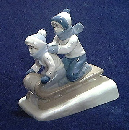 CHILDREN SLEDDING FIGURINE ~PORCELANA DE CUERNAVACA~MEXICO~CHARMING