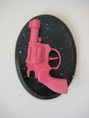 pink gun on black