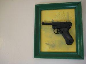 black gun on yellow and green