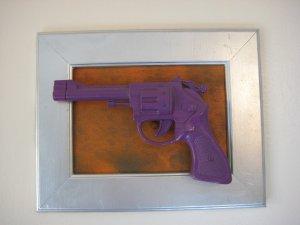 purple gun on orange and silver