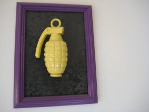 yellow grenade on black and purple