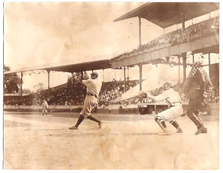 Real Photo of Babe Ruth at bat with Garret catching 1920