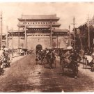 Real Photo of rickshaws, carts & people on Chien Men street, Beijing, 1900