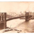 Real Photo of the Brooklyn Bridge across the East River w/view of Manhattan skyline, 1915