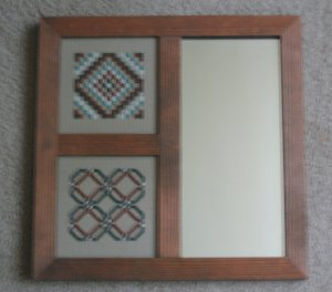 Stitched pieces in 3 section mirror frame