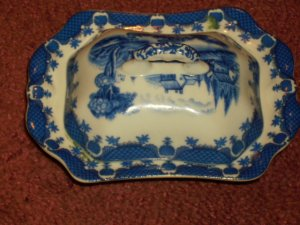 blue and white butter server