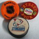 Hockey Pucks Franklin STREET ROLLER Orange + Stingrays + Looney Tunes