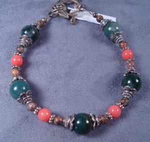 Coral Bracelet with bali style bead caps