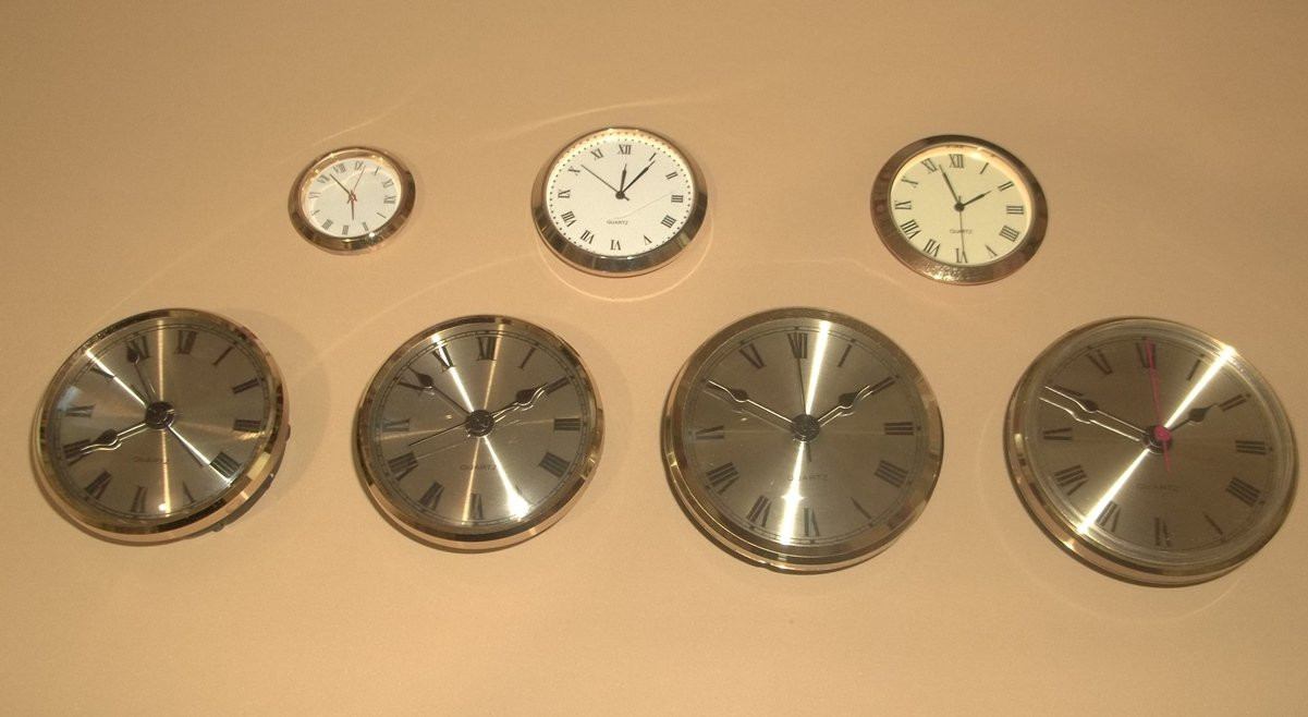 7 Pc Set Clock Inserts/Fitups With White, Ivory Dials and Spun Brass Custom and Designer Dials