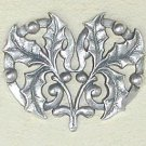 Art Nouveau style brooch design of a sprig of Holly