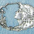 Art Nouveau style brooch design of the head of Excalibur