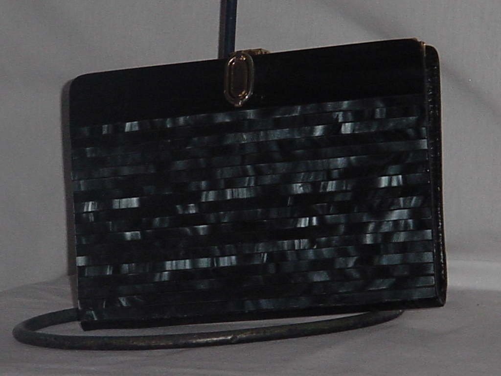 Black pearlized plastic clutch purse   No. 138