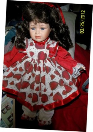 Porcelain Face Child-like Doll  w/hearts