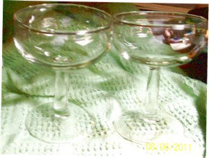 A Set of Two Glass Champagne Glasses