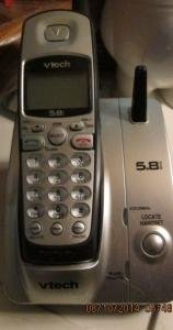 Two cordless phones with units