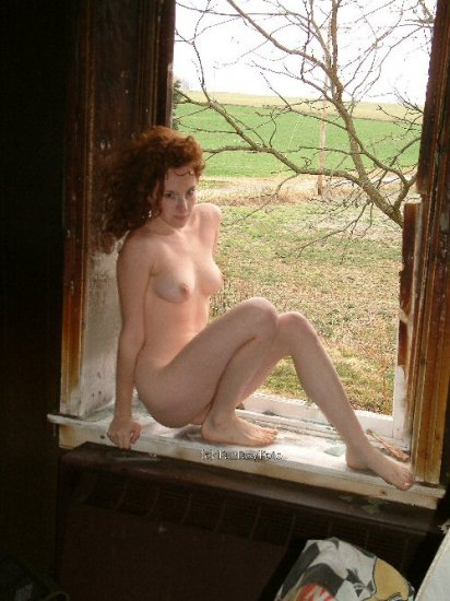 Hot Redhead Stripper in the burned hou farmhouse  02