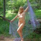 Beautiful Hot Blond Babe posing along a trail in a city park