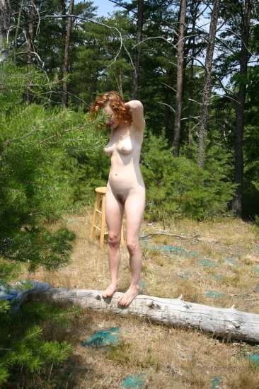 Hot naked redhead outdoors
