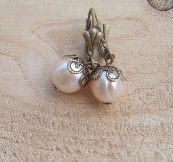 Peach pearls in my ears