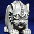 Dog gargoyle sculpture