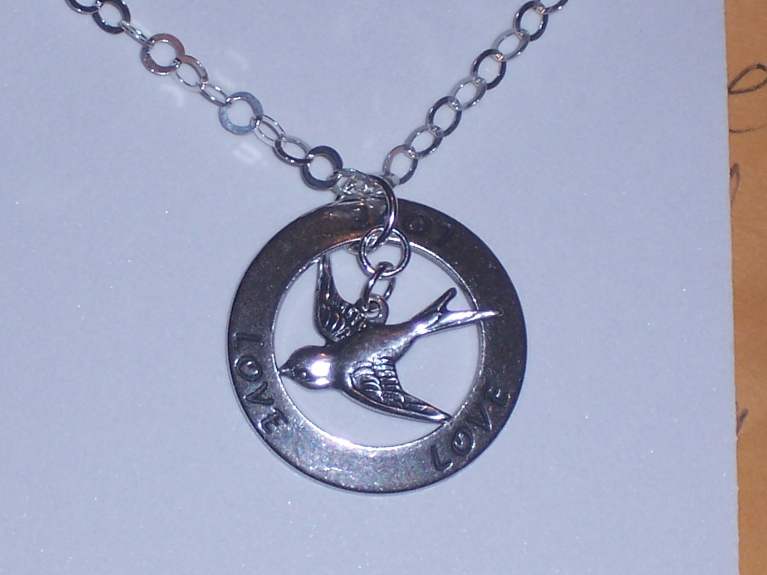 Sparrow Bird Necklace over a Love Circle Ring on Sterling silver Chain FREE SHIPPING TO THE U.S.