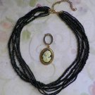 Multi-Strand Black Seed Bead Necklace with Cameo Enhancer