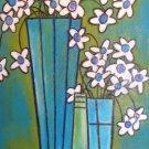 White Flowers in Blue Vases